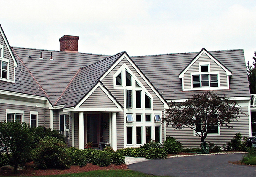 Standing Seam Vs. Stamped Metal Shingle Roofing: Longevity